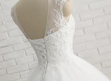 فستان عروس جديد غير ملبوس لون ابيض والقياس 38