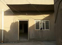 بيت في منطقه تجاريه في الديوانيه