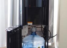 water dispenser and cooler with built in bottle براد مياه مع القنينة فيداخله  ا