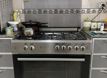 طباخ cooker