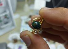 خاتم من حجر الاوبال الإثيوبي والذهب البحريني