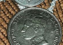 عملة اسبانيا قديمة بقيمة 2 بسيطة تعود لسنة 1905 وأخرى للمكسيك 1 دولار لسنة 2007
