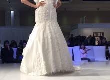 فستان زفاف للمصممة غدير افغاني مع الطرحة