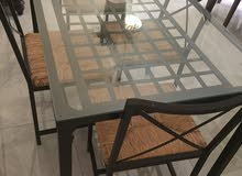 A glass Table with 4 chairs l