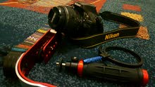 Nikon D5200 with18-55mm VR Lens Kit بحال الوكالة