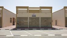 للبيع محلات تجارية في الزاهية عجمان علي شارع رئيسي بعرض 40 م ` RT
