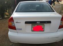 هونداي فيرنا موديل 1999 محرك 1300cاربعه جيد مطلوب 5000 رقم 0777039924
