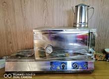 سخان ماء مع غاز كهرباء وكاله