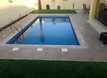 swimming pool and garden landscaping.