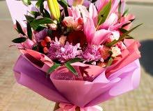 خدمة تنسيق الزهور مع التوصيل المجاني