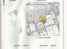 للبيع ارض في ضاحية السيف - قرب مجمع الدانة