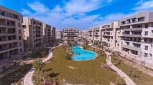 شقة ارضي بحديقة جاهزة في كمبوند التجمع وبسعر خرافي