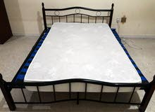 A double coat bed frame along with mattreas for sale