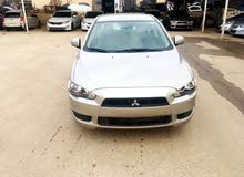 Mitsubishi Lancer 2016 For sale - Gold color