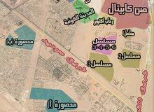 ارض للبؤيع بالمحصورة ب ناصية علي منطقة خضراء 447مترا