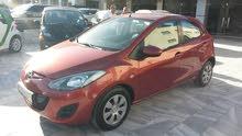 Orange Mazda 2 2012 for sale