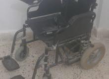 كرسي كهربائي في حالة ممتازة لذوي الاحتياجات الخاصة