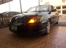 Blue Mitsubishi Lancer 2009 for rent