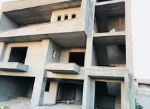 مبني قيد الإنشاء  في شارع ولي العهد طريق المطار علي الأسفلت فرعي