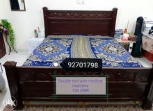 Double Wooden Bed with Medicated Mattress.