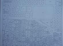 عماره ثلاث طوابق للبيع في الزرقاء حي الضاهريه