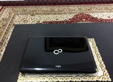 Fujitsu Pantium (320gb Hdd)(6gb Ram) Bluetooth - dvd writer - windows7 - original charger