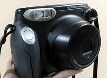 كاميرا+فلم+بطاريات  ماركة FujiFilm