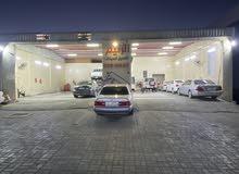 مغسله سيارات وبوليش  صناعيه العين للبيع للتواصل على الرقم 0569060234