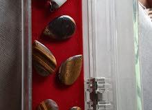 سن فيل + حجارة كريمة من نوع تايغر  ( عين النمر )