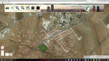 قطعة ارض ام اللولو محاذيه للتنظيم على الشارع الرئيسي