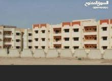 شقة للبيع في مجمع حي الحسين الجديد
