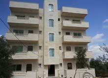 للبيع بنايتان ديلوكس مع  ارض مجاورة - بيت راس - اربد