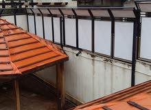 ابواب خشب مستعملة بحالة الوكالة وحمايات وأبواب حديد ودربزينات درج وسور وقرم كله