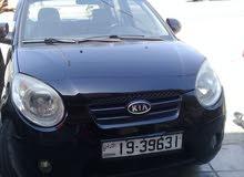 Manual Black Kia 2009 for rent