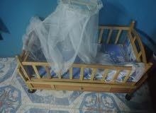 سرير طفل شبه جديد