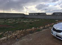 قطعة أرض في بوعطني 500 متر في شارع البيبسي بعد الشيل