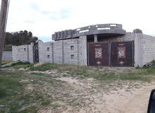 منزل للبيع تاجوراء النشيع بعد الجامع الجديد على اليسار