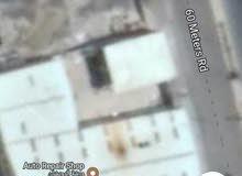 ارضيه في شارع الستين على الشارع الرئيسي جمب عماره الرويشان قبل جوله المصباحي
