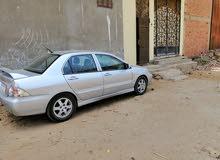 سيارة لانسر بومة  2009 بحالة جيدة جدا للمشاوير من الزقازيق او العاشر  للمحافظات