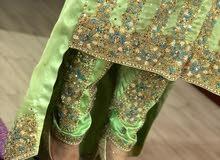 ملابس تقليدي ظفاري مطور
