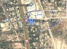 قطعه ارض للبيع مساحه 121 متر  الواجه  10 النزال 12  في حي الجزائر خلف مكبس التمو
