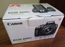 للبيع جديدة Canon 4000D مصورة فقط 300 صورة