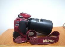 كاميرا نيكون D3300 عليها عدسة تامرون ( TAMRON) 70-300 mm