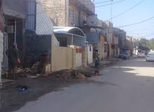 مشتمل جديد في بغداد الجديدة على شارع عام