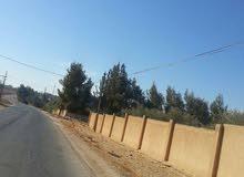 قطعة أرض في منطقة الذهيبة الغربية خلف جامعة الإسراء قرب شارع المطار قريبة من الطنيب بسعر مغري