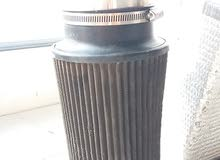 Universal K&n air filter size 4.0 inches with intake tube along with heat shield in great condition