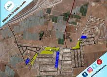 قطعة أرض إستثمارية مميزة في منطقة الذهيبة الغربية على الشارع الرئيسي شارع ال 30 طريق المطار