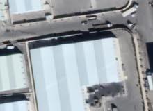 هنجر صناعي/ تجاري مساحة 5,000 متر. مساحة الارض 10,000 متر