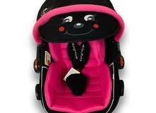 كرسي سيارة للاطفال ويستخدم شيال و هزاز