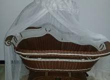 سرير اطفال شبه جديد هزاز بريموت